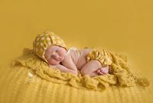 Newborn prop posing