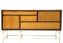 Edward Wormley / (December 31, 1907 – November 3, 1995)  American designer of modernist furniture. In 1926 he went to study briefly at the Art Institute of Chicago. Funds ran out and he went to work as an interior designer for Marshall Fields & Company department store. During the Depression, Wormley was introduced to the president of Dunbar Furniture Company of Berne, Indiana, who hired him to upgrade their product line.