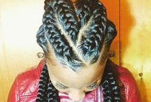 Goddess braids / Goddess braids resemble thicker cornrows where the hair is braided closely to the scalp. The braids are typically more defined than regular cornrows.