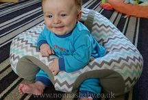 Happy babies in their Hugaboo baby seat / Some happy customers from around the world loving their Hugaboo baby seat