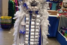 (Plush) Homecoming Mums / The pins on this board are homecoming mums that feature a stuffed animal as a centerpiece.