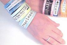 WE day bracelet / by Karen Langill