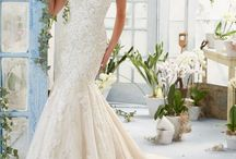 Wedding Dresses / by April Martin
