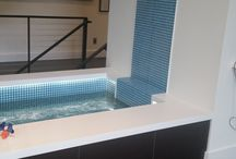 Glass Mosaic Tiles / In this home, we installed glass mosaic tile on the wall and inside of the indoor pond filled with fish.