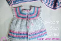 Crochet/Children's and Baby Clothing / Booties, Sweater Sets, Dresses, etc. / by Cheryl Mook