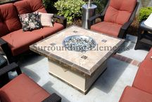 """Mosaic Chat Height Fire Pit Tables / Surrounding Elements Firepits are approximately 21"""" high.  You can choose from one of our standard designs, in the colors of your choice or work with one of our Sales Associates to create your own design. Our table tops are hand-laid with the finest natural stones and porcelain tiles. Add some conversation height chairs to make a cozy conversation area."""
