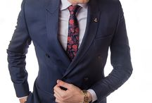 PIETER PETROS || NAVY I / A traditional Double-breasted Navy suit with Maroon-red detailing that gives it an elegant yet bold look.