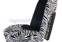 The Beauty of Zebra Prints: Zebra Chairs / This zebra print microfiber accent chair is wonderfully made. This accent chair is made of gold and black zebra fabric with cappuccino legs. It is made beautiful. Quality of this chair is good. It looks great and well made.
