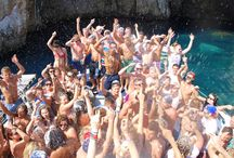 Kavos Booze Cruise  / Join Theo and the crew, along with your reps, for a day of sun, fun and a day you may not remember but you definitely wont forget!  We depart from the Kavos jetty at about 10.45 and we head to the fantastic private beach of Kalamas on the mainland. A breakfast shot will get you started and into gear for the chaos of the day ahead. There will be a few games to warm you up and some time to chill and get rid of that hangover.