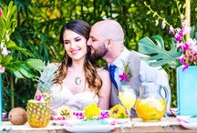 Tropical Oasis Styled Shoot / Tropical Oasis beach wedding photo shoot.  The bright, vibrant color against the lush greens and golden sand beach are perfection.