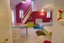 Children's beach themed playroom & bedroom / Project: to create a bedroom/playroom for triplets from a guest bedroom. Included adding a mezzanine floor.  Sliding barn door to en-suite bathroom.