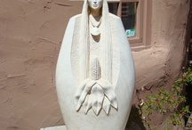 Corn Mother / Mother of the First Americans, called Ginitsi Selu by the Cherokee, Corn Maiden in the Southwest. Kanatu is her mate. Associated with Mother Earth. Also, corn and cornfields.