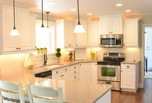 Gorgeous Kitchen Makeover by The Idea Room! Love the recess lighting and the hanging lights.