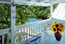 Flower Power House ~ Key West ~ Weekly Rental 5 BR + Sleeping Porch - 4BA - Sleeps 12+ / The free-spirited presence of the Flower Power House ~ Key West weekly rental ~  has much more in common with the real Key West than the shiny hotels around town. 6BR 4BA Sleeps 12 – 14 Winter $6475. per wk/ Shoulder $5950. per wk/ Summer $4950. per wk/