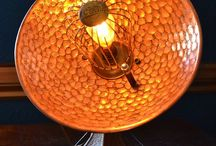 """'Retro-electro' Table lamp / Spotted at an antiques fair in Malvern, Worcestershire this 1920s electric heater spoke to me (it said """"buy me and turn me into a light"""").  My reward was this amazing copper reflector on an Art Deco style cast base, ideal for transformation into another piece of funky lighting.  Keeping the look and feel of the original fire was important and using the original guard around the bulb was essential to the integrity of the piece.  """"Copper is the new chrome"""""""