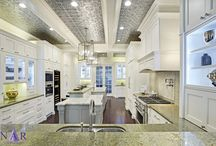 NFC Portfolio: French Laundry Kitchen / Inspired by classic gourmet styling of the prestigious French Laundry restaurant in the Napa Valley. Classic traditional elements are seen in the pattered tin ceiling, crown moldings, and island column details. With a professional range, baking station, and bar height seating for four, this is a dream kitchen for any gourmet! Designer: Amanda Fossum Design Contractor/Cabinetry: Nar Fine Carpentry, Inc.