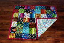 Tshirt Quilts and Memory Quilts / I make several types of quilts, the most common being Tshirt quilts. The customer sends me their own shirts and then chooses the color etc they want and I create their custom made quilt. / by Jenn Wells