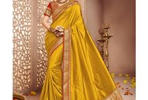 Attractive Golden Sarees / Slip into the rich and royal appeal of dazzling golden designer sarees and make heads turn around!!!