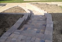 Camelot Paver Projects / Precision Corporation creates beautiful patios and hardscape accents using Camelot-style paver bricks.