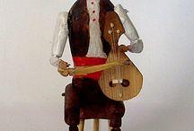 Kemane player - wooden doll