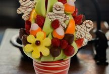 Halloween Party Ideas - Fruit Arrangements / Blossom Fruit Arrangements Spooky pineapples that will haunt you with every bite. Eerie pumpkins made of pineapple and chocolate that will delight your senses while leaving you quivering with fright. Halloween decoration, Halloween Party centerpiece