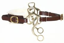 Hackamore / The hackamore is bit-less and acts like a curb bit. It uses leverage on the nose and poll, a leather curb band presses behind the chin. The shorter the shanks the less severe is the pressure. Shanks that curve back are less severe than straight shanks.