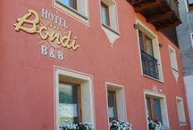 """Hotel B&B Bondi Livigno / For one unforgettable holiday in winter with the snowflakes and in summer with a fresh air awaits you, happy to give you a very warm welcome in a friendly and hospitable, sport and relaxation. If you are looking a bit 'of peace, a short walk from the main street of the village, this is the place for you. """"BONDI"""" Hotel B&B is a 3 star family hotel and BRAND NEW CONSTRUCTION. The architecture, the mountain atmosphere and the environment communicate a family atmosphere throughout your vacation."""