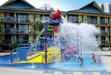 Junior Waterpark / The littlies have their own smaller version of the main waterpark which includes a slippery slide, water cannons and giant tipping water bucket. There's also a paddling area especially for them, with a gently sloping beach entry.