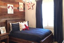 Reclaimed Wood- Rustic Sports Room / We hit a home run with this interior design project. Vintage baseball meets rustic reclaimed wood. Love the pop of red and navy as well. / by Shalena Smith