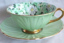 Lovely antique tea cups and saucers / I would love to take up a collection.