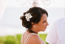 Maui Wedding Hair and Make-Up / Our brides get ready for their ceremony and reception in our Bridal Salon. Hair and make-up and finally getting into the wedding dress are all key moments. Here is a collection of some of our favorite Bride Hairstyles from the Maui weddings that have taken place at our beautiful Maui venue, Sugar Beach Events.