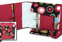 Stylin' Binders / You can carry your coupons with pride in this STYLIN' BINDER BAG. It is a 3-ring binder disguised as a really cute tote! With pockets on the inside for your calculator, credit and store cards, you can bring your whole coupon stash and never miss out on that deal again. Side flaps unfasten to open the tote, so you can lay the binder flat. In addition, it's easy to carry hands-free with kids in tow. Sport this coupon organizer like a purse, open it when you're ready, and browse your coupons on the go!  No more finagling that giant, unsightly binder while juggling your shopping list and purse. No more feeling embarrassed while you clumsily rifle through your purse at the register. No more irritated glares from the shoppers behind you in line. Best of all, you're organized and looking pretty cute!  If you are one of those smart, frugal, coupon ladies, this STYLIN' BINDER BAG is for you!  Three ring binder not included to help keep the shipping costs down. Buy a 3-inch economy Avery brand binder. The best price we've seen is at Walmart.
