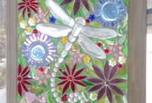 whimsical stained glass window panel with dragon flies and flowers