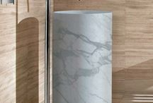 Marble Sinks / If you are looking to make a statement in your bathroom renovation, there is no better way than vessel sinks.  Often featuring marble in shades of white and grey with variations in veining, vessel sinks introduce a high-end architectural element and offer design solutions for those looking to feature natural stone in their project.