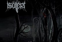 Isolert / Black Metal Band. Of the melodic kind. But it IS Black Metal after all.