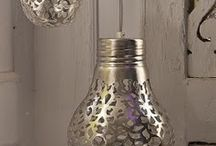 Get a lace doily and spray paint the pattern onto a light bulb. When the light is on, the pattern will shine through on your walls.
