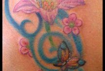 tattoos / by Lisa Mills