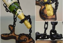 'Prometheus Bound' Masterpiece 52.06.16 / Handmade wine base made of iron chain and scorched beech wood . The chain after the electrowelding, painted with electrostatic black matte color . The wooden base after the scorching style , painted with transparent varnish. For any further explanation we will be glad to assist you via message at our facebook page https://www.facebook.com/artstreet52/ Dont forget to like us pls!!