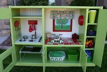 If I had the time and space... / Wouldn't it be fun to make cute little play kitchens like these. It's as if some Fairypaint Mother touched old castoff pieces of furniture and and turned them into charming play areas for little girls. What makes them a little more special is that each one is so unique.