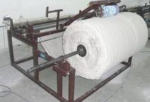 Derulator gofrator cu pretaiere a rolelor de hartie igienica si a prosopului din hartie