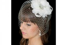 Bird Cage Veils / We stock a stylish range of handmade floral white birdcage veils. All our products are made of pearl and crystal