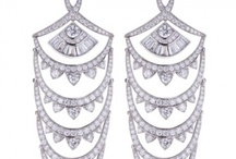 Diamond Chandelier's / Chandelier: a french term for a decorative glass piece hanging from ceiling… similarly Diamond Chandelier hang from your Ears and are elongated from 3-5 inches… their movement bring additional Sparkle to the Jewellery…. in India similiar pattern earrings are known as Jhoomka (झूमका). Handcrafted in India, upon Customization they can fit everyone's Style and Budget