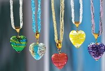 Giulio's Hearts of Murano Glass / These beautiful Murano glass pendants give new meaning to keeping something precious close to your heart. Each of these treasures is made with love by the heart and hands of our artisan, Giulio. In his Castello studio, just a short walk from Venice's famed St. Mark's square, Giulio continues the lampwork tradition of his grandmother. Each of the beads in his stunning pieces is handmade, one at a time, over a small flame: http://www.unoallavolta.com/murano-glass-heart-jewelry/c/58105/c2c/ln/