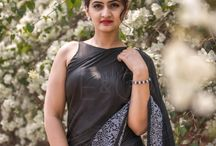 Aratrika Black Pure Satin Embroidered Saree / PRICE INR 9,498/-; US$ 143.00 To buy click here https://www.eastandgrace.com/products/aratrika-black-silk-satin-saree Featuring the Aratrika, black pure satin embroidered saree with a thick, hand-embroidered, white, spring floral detailing along a border. The black, satin blouse has a halter neckline and charming tie-back, large bow. Your key to winning hearts with black and white. Reach us: care@eastandgrace.com