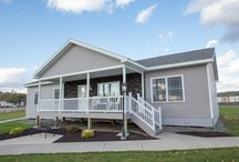 Model 7 / You can have the home you've always wanted in this ranch style modular home. It features three bedrooms, a master bathroom with a garden tub and walk in closets. This Kitner Modular Home also features a large living room and a family room with cathedral ceilings