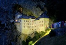 Predjama castle, Slovenia / Impressively built in to a rock cliff, Predjama castle surprises its visitors with its complex maze of halls and rooms that ends in the castle's very own cave and imagination-stirring legends that bring the castle back to life.