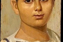 Fayum mummy portraits / Painted mummy cover of a young boy, identified by inscription as Eutyches, dating to the Roman Period, 2nd century A.D., made of encaustic on wood. On display at the Metropolitan Museum of Art