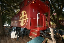 B&B - Stay in A Themed Train Caboose! / If you're looking for a resort bed and breakfast on the shores of Clear Lake, California that features unique, individual rooms, our cabooses might be the perfect spot. Each of our nine luxuriously appointed cabooses is decorated in a unique theme to celebrate your style and taste. From mild to wild, these romantic rooms are the perfect home base for a honeymoon, anniversary, birthday or just for a break. AND, We're winners of the 2012 Best of BedandBreakfast.com Award for best themed B&B!  / by Featherbed Railroad
