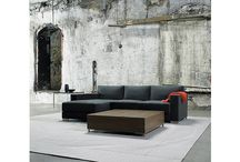 Grand / Grand is a classic design updated to a modern sofa series with a taut, tailored look. Legs are made in metal or wood. A square coffee table complements the series.