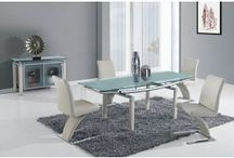 Dining Rooms / This modern Italian Design extendable dining table comes in a beautiful silver color that will give your dining space a clean and elegant new look. Featuring Stylishly bold legs, this dining table will compliment your home alone, and even better with Dining Chairs and Buffet. https://choicecustomhome.com/catalog/diningroom